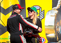 Sep 15, 2019; Mohnton, PA, USA; NHRA top fuel driver Steve Torrence hugs Brittany Force during the Reading Nationals at Maple Grove Raceway. Mandatory Credit: Mark J. Rebilas-USA TODAY Sports