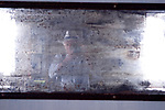 Homer Sykes, photographer, self portrait, in distressed mirror. Venice Italy 2009.