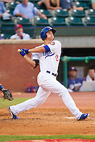 Corey Seager (12) of the Chattanooga Lookouts follows through on his swing against the Montgomery Biscuits at AT&T Field on July 24, 2014 in Chattanooga, Tennessee.  The Biscuits defeated the Lookouts 6-4. (Brian Westerholt/Four Seam Images)