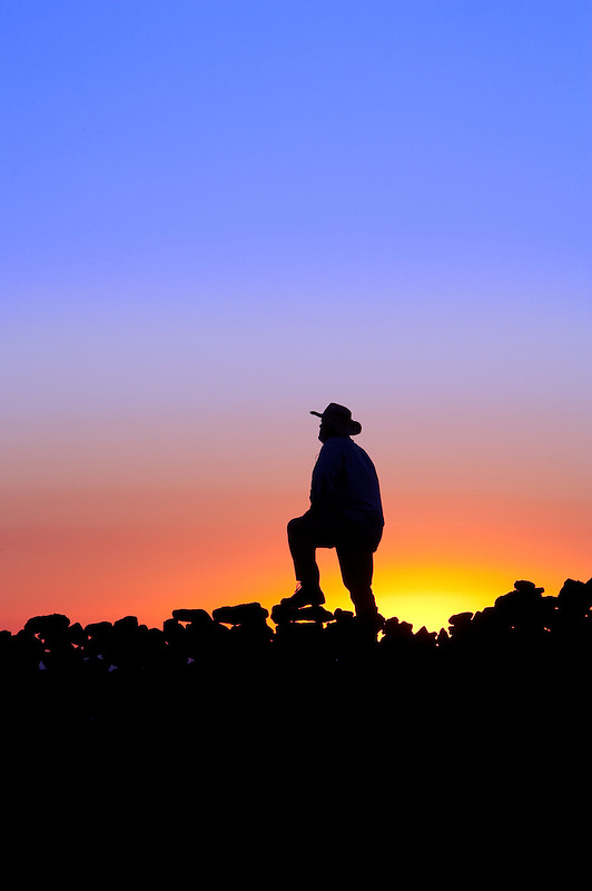 Silhoutte of man on rock outcrop. Steens Mountain. Oregon