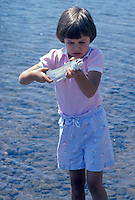 Young girl holding rainbow just caught trout. Willamette River, Oregon