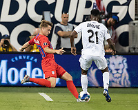 KANSAS CITY, KS - JUNE 26: Djordje Mihalovic #20 shoots the ball as Omar Browne #21 looks on during a game between Panama and USMNT at Children's Mercy Park on June 26, 2019 in Kansas City, Kansas.