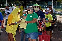 Fans wearing a required protective mask get their tickets scanned before a Collegiate Summer League game  between the Macon Bacon and Savannah Bananas on July 15, 2020 at Grayson Stadium in Savannah, Georgia.  (Mike Janes/Four Seam Images)