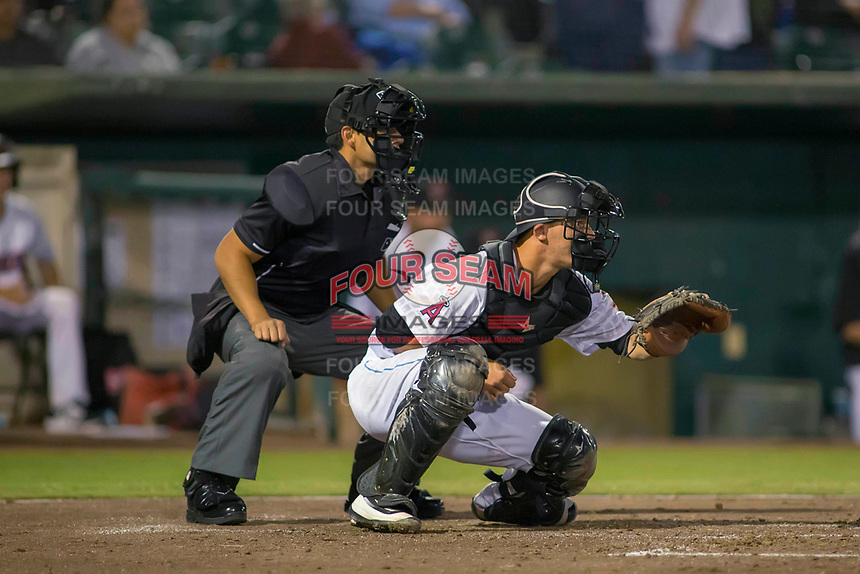 Inland Empire 66ers catcher Jack Kruger (27) sets a target a home plate umpire Ricky Estrada looks on during the game between the San Jose Giants and the Inland Empire 66ers at San Manuel Stadium on April 5, 2018 in San Bernardino, California. (Donn Parris/Four Seam Images)