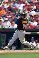 Pittsburgh Pirates  third baseman Pedro Alvarez #24 follows through during the Major League Baseball game against the Philadelphia Phillies on June 28, 2012 at Citizens Bank Park in Philadelphia, Pennsylvania. The Pirates defeated the Phillies 5-4. (Andrew Woolley/Four Seam Images).