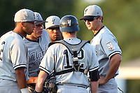 Staten Island Yankees Danny Borrell #61 talks with catcher Nick McCoy #12, shortstop Cito Culver #2, pitcher Richard Martinez #38, and second baseman Angelo Gumbs #21 during a game against the Batavia Muckdogs at Dwyer Stadium on July 29, 2011 in Batavia, New York.  Staten Island defeated Batavia 10-7.  (Mike Janes/Four Seam Images)