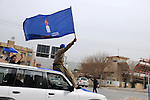 """SULAIMANIYAH, IRAQ:  A man rides down the street waving the flag of the Kurdish """"Change"""" party on the first day of official election campaigning...Election workers start their campaigns for the Iraqi Parliamentary Elections due to be held March 7th, 2010...Photo by Pazhar Muhammed/Metrography"""