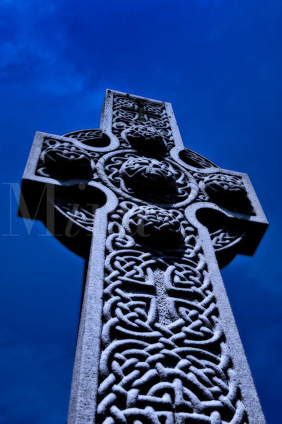 Celtic high cross at dusk.