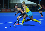 NZ's Kelsey Smith and Australia's Georgia Wilson compete for the ball during the Sentinel Homes Trans Tasman Series hockey match between the New Zealand Black Sticks Women and the Australian Hockeyroos at Massey University Hockey Turf in Palmerston North, New Zealand on Tuesday, 1 June 2021. Photo: Dave Lintott / lintottphoto.co.nz