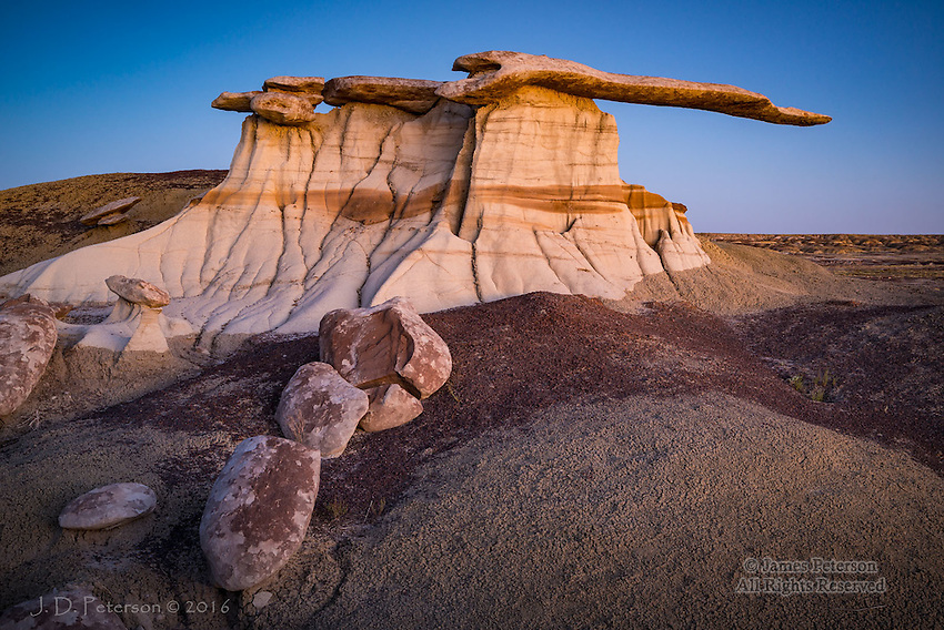 King of Wings at Dusk, New Mexico ©2016 James D Peterson.  The badlands of northwestern New Mexico include some of the most remarkable rock formations on the planet.  This image was made about 20 minutes after sunset, when the scene was illuminated by the warm glow in the western sky.