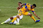 Javier Aquino of Tigres UANL (MEX) fights for the ball against Javier Portillo of CD Olimpia (HON) during their CONCACAF Champions League Semi Finals match at the Orlando's Exploria Stadium on 19 December 2020, in Florida, USA. Photo by Victor Fraile / Power Sport Images