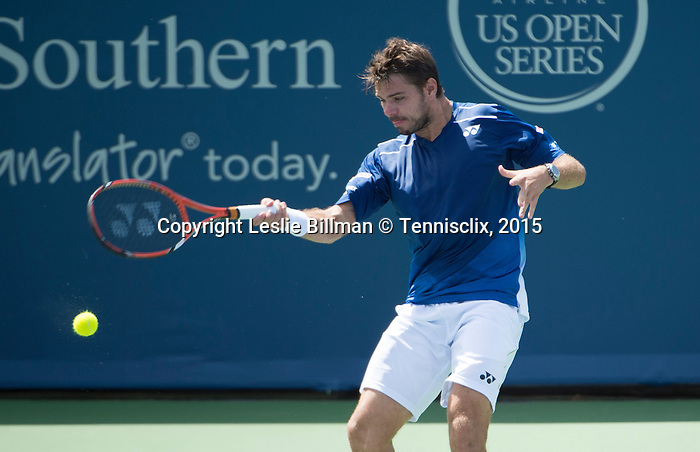 Stanislas Wawrinka (SUI) battles Ivo Karolovic (CRO) at the Western and Southern Open in Mason, OH on August 20, 2015.