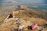 After more than 30 years of war, Afghanistan is one of the countries in the world most affected by landmines and other explosive remnants of war. On this hike over Kabul wall, the red paint shows an unexploded ordinance.