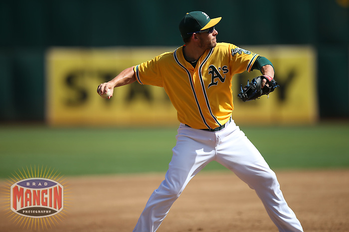 OAKLAND, CA - SEPTEMBER 24:  Danny Valencia #26 of the Oakland Athletics makes a play at third base against the Texas Rangers during the game at O.co Coliseum on Thursday, September 24, 2015 in Oakland, California. Photo by Brad Mangin