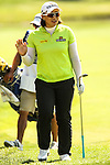 South Korean Amy Yang waves to the crowd after chipping her ball on the seventh green during Round 3 at the LPGA Championship at Locust Hill Country Club in Pittsford, NY on June 9, 2013