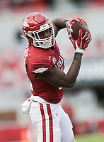 Arkansas wide receiver Treylon Burks (16) completes a pass, Saturday, October 17, 2020 during the second quarter of a football game at Donald W. Reynolds Razorback Stadium in Fayetteville. Check out nwaonline.com/201018Daily/ for today's photo gallery. <br /> (NWA Democrat-Gazette/Charlie Kaijo)