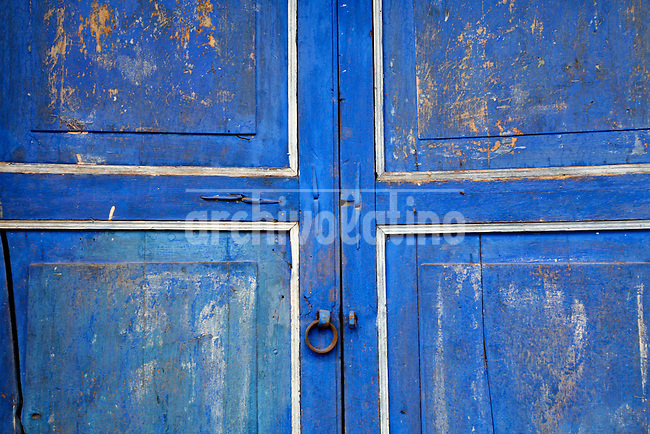 """A painted residential door sits in the village of Andahuaylillas, Peru, on May 13, 2008. San Pedro de Andahuaylillas is considered ad the """"Sistine Chapel"""" of America due to the quality of its art pieces."""