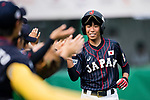 #25 Kitayama Miku high five with her teammates during the BFA Women's Baseball Asian Cup match between South Korea and Japan at Sai Tso Wan Recreation Ground on September 2, 2017 in Hong Kong. Photo by Marcio Rodrigo Machado / Power Sport Images