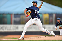 Asheville Tourists starting pitcher Alfredo Garcia (26) delivers a pitch during a game against the West Virginia Power at McCormick Field on April 18, 2019 in Asheville, North Carolina. The Power defeated the Tourists 12-7. (Tony Farlow/Four Seam Images)