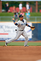 West Michigan Whitecaps third baseman Isaac Paredes (11) throws to first base during the first game of a doubleheader against the Lake County Captains on August 6, 2017 at Classic Park in Eastlake, Ohio.  Lake County defeated West Michigan 4-0.  (Mike Janes/Four Seam Images)