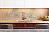 This custom kitchen features a handmade Ikebana mosaic backsplash shown in honed Lagos Gold, Verde Luna, Travertine Noce and polished Topaz Onyx by James Duncan for New Ravenna.<br /> <br /> For pricing, samples and design help, please click here: http://www.newravenna.com/showrooms/