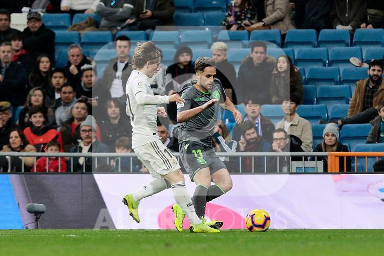 Real Madrid's Luka Modric and Real Sociedad's Adnan Januzaj during La Liga match between Real Madrid and Real Sociedad at Santiago Bernabeu Stadium in Madrid, Spain. January 06, 2019. (ALTERPHOTOS/A. Perez Meca)<br />  (ALTERPHOTOS/A. Perez Meca)