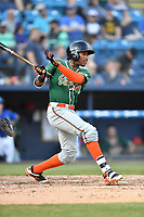 Greensboro Grasshoppers second baseman Garvis Lara (8) swings at a pitch during a game against the Asheville Tourists at McCormick Field on May 10, 2018 in Asheville, North Carolina. The Tourists defeated the Grasshoppers 9-3. (Tony Farlow/Four Seam Images)