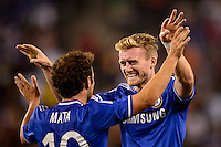 Chelsea F. C. forward Andre Schurrle (14) celebrates scoring with midfielder Juan Mata (10). Chelsea F. C. defeated A. C. Milan 2-0 during round two of the 2013 Guinness International Champions Cup at MetLife Stadium in East Rutherford, NJ, on August 04, 2013.