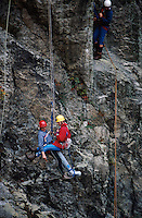 Mountain rescue team rescuing a climber with a broken leg and foot from a crag face. They are lowering him on a specially designed harness used for recovering casualties from remote places. This image may only be used to portray the subject in a positive manner..©shoutpictures.com..john@shoutpictures.com