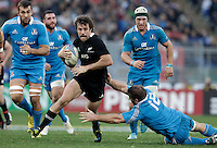 Rugby: test match Italia vs Nuova Zelanda. Roma, stadio Olimpico, 17 novembre 2012..New Zealand's Conrad Smith is tackled by Italy's Lorenzo Cittadini, bottom right, during an international rugby test match between Italy and New Zealand at Rome's Olympic stadium, 17 November 2012..UPDATE IMAGES PRESS/Riccardo De Luca