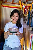Mongolia, Ovorkhangai Province, Kharakhorum, Orkhon Bag. Undraa, our guide drinking vodka.
