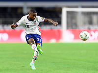 DALLAS, TX - JULY 25: Shaq Moore #20 of the United States passes the ball to a teammate during a game between Jamaica and USMNT at AT&T Stadium on July 25, 2021 in Dallas, Texas.