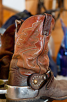 Well used western boots with silver spurs