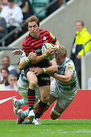 Chris Wyles of Saracens looks to offload in the tackle during the Aviva Premiership match between Saracens and London Irish at Twickenham on Saturday 1st September 2012 (Photo by Rob Munro)