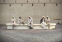 Al Ain, UAE, March 1972. Emirati Men Socializing in Late Afternoon.