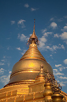 Myanmar, Burma, Mandalay.  Kuthodaw Temple, around which 729 marble slabs display the 15 books of the Tripitaka, each page housed in a separate stupa.  Construction began 1857.  The protective umbrella atop the stupa is called a hti.