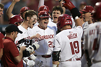 Arkansas players react following a score, Monday, June 7, 2021 in the eighth inning of the NCAA Fayetteville Regional at Baum-Walker Stadium in Fayetteville. Check out nwaonline.com/210608Daily/ for today's photo gallery. <br /> (NWA Democrat-Gazette/Charlie Kaijo)