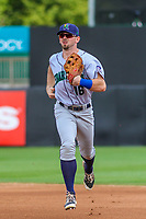 Cedar Rapids Kernels outfielder Jimmy Kerrigan (16) jogs into the dugout between innings during a Midwest League game against the Wisconsin Timber Rattlers on August 6, 2017 at Fox Cities Stadium in Appleton, Wisconsin.  Cedar Rapids defeated Wisconsin 4-0. (Brad Krause/Four Seam Images)