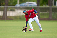 FCL Twins outfielder Emmanuel Rodriguez (4) fields a ground ball during a game against the FCL Boston Red Sox on July 3, 2021 at CenturyLink Sports Complex in Fort Myers, Florida.  (Mike Janes/Four Seam Images)