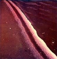 Stripe of salt along edge of sand<br />