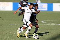RICHMOND, VA - SEPTEMBER 30: DJ Taylor #27 of North Carolina FC is challenged for the ball by Bo Cummins #83 of New York Red Bulls II during a game between North Carolina FC and New York Red Bulls II at City Stadium on September 30, 2020 in Richmond, Virginia.