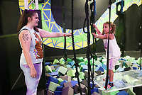 Kari Hoag of Vernal, Utah (from left) holds her arm out in support of Whitney Hoag, 5, as she makes her way through an obstacle course, Friday, July 16, 2021 at Defy Rogers in Rogers. Kids played on trampolines, trapezes and in foam pits at the trampoline and extreme airsports park. Check out nwaonline.com/210717Daily/ for today's photo gallery. <br /> (NWA Democrat-Gazette/Charlie Kaijo)