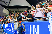 FRISCO, TX - MARCH 11: Julie Ertz #8 of the United States signing autographs for the fans during a game between Japan and USWNT at Toyota Stadium on March 11, 2020 in Frisco, Texas.
