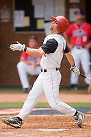 Jimmy Parque #4 of the St. John's Red Storm follows through on his swing against the Ole Miss Rebels at the Charlottesville Regional of the 2010 College World Series at Davenport Field on June 6, 2010, in Charlottesville, Virginia.  The Red Storm defeated the Rebels 20-16.  Photo by Brian Westerholt / Four Seam Images
