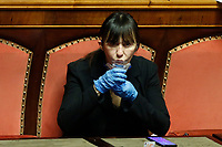 A senator take off her mask to drink<br /> Rome March 26th 2020. Senate. Information of the Italian Premier about the measures adopted to contrast Coronavirus, Covid-19.<br /> Photo Samantha Zucchi Insidefoto