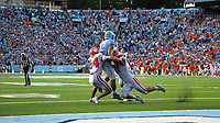 CHAPEL HILL, NC - SEPTEMBER 28: Sam Howell #7 of the University of North Carolina is stopped by Nolan Turner #24 and LaVonta Bentley #42 of Clemson University while attempting a go ahead two point conversion with just over a minute left during a game between Clemson University and University of North Carolina at Kenan Memorial Stadium on September 28, 2019 in Chapel Hill, North Carolina.