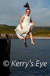 'I'm Walking on Air', nine year old Ellis O'Donoghue from Bahaghs, Cahersiveen takes a leap from the pier at Cuas Crom just days after making her first Holy Communion.