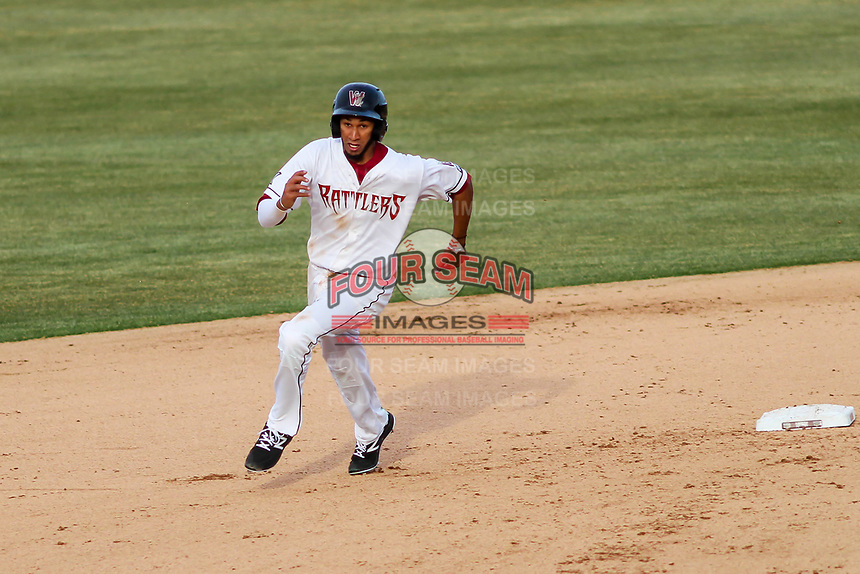 Wisconsin Timber Rattlers infielder Jonathan Oquendo (2) races to third base during a Midwest League game against the Quad Cities River Bandits on April 8, 2017 at Fox Cities Stadium in Appleton, Wisconsin.  Wisconsin defeated Quad Cities 3-2. (Brad Krause/Four Seam Images)
