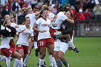 18 November 2007: Ali Riley, Allison Falk, Kristin Stannard, Christen Press, Alicia Jenkins, Lizzy George, and Kelley O'Hara congratulate Allison Falk and Alex Gamble during Stanford's 1-1 double overtime shootout win over California in the second round of the NCAA Division 1 Women's Soccer Championships at Laird Q. Cagan Stadium in Stanford, CA.