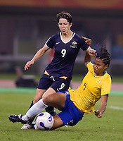 Australia forward (9) Sarah Walsh has the ball tackled away from her in the box by midfielder (5) Renata Costa during the quarterfinals of the FIFA Women's World Cup at Tianjin Olympic Center Stadium in Tianjin, China.  Brazil defeated Australia, 3-2.